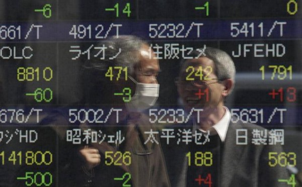 Asian Shares Fall as U.S. Data Weakens