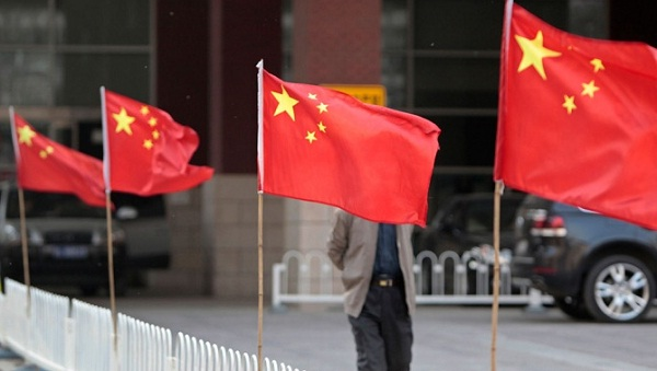 China's economy rises in 4Q but 2012 GDP is weakest in 13 years