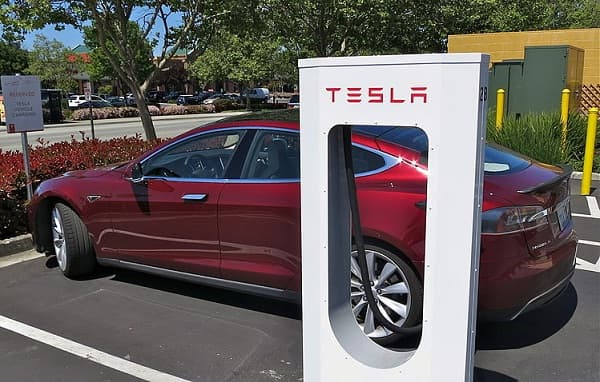 Tesla gathers pace as it plans new charging stations