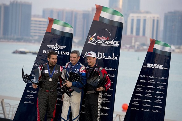 (Image Credit: Red Bull) Hannes Archof Austria (L), Paul Bonhomme of Great Britain (C) and Pete McLeod of Canada (R) celebrate on the Award Ceremony for the first stage of the Red Bull Air Race World Championship in Abu Dhabi, United Arab Emirates on March 1, 2014.