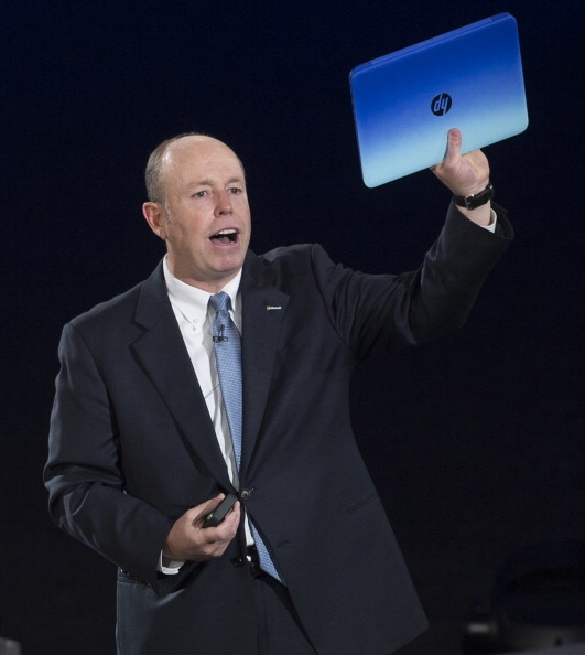 Microsoft Chief Operating Officer Kevin Turner holds up a HP Stream laptop.
