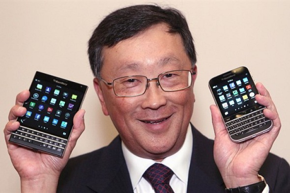 BlackBerry CEO John Chen shows off the new Passport (left) and Classic phone models.