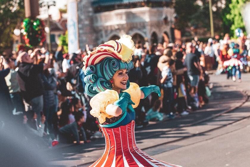 Walt Disney layoffs 32,000 COVID-19 impact theme parks industry